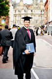 A day to be proud 2. A young graduating posing with his father on his graduation day Stock Photo