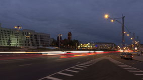 From day to night city traffic. Zoom out, time-lapse shot stock video footage