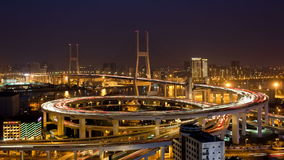 Day to night high angle wide shot traffic on Nanpu bridge spiral Shanghai stock footage