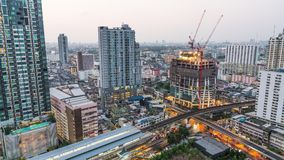 Day to night holy grail time-lapse of construction site and traffic in city. Advanced building technology, city life concept stock footage
