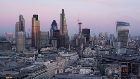 Day to night time-lapse of the business district of London. Elevated view - day to night time-lapse of the business district of London, England stock footage