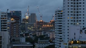 Day to night time lapse of construction cranes. In Bangkok, Thailand stock video