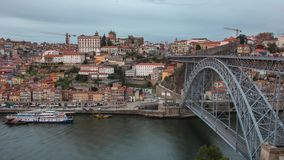 Day to night time lapse of the historic city center of Porto with the famous ponte Dom Luiz bridge. Portugal stock video footage