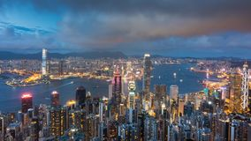Day to night time lapse of Hong Kong cityscape aerial view from victoria peak on high mountain, famous landmark for travel in Hong