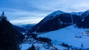 Alpine valley day to night time lapse. Day to night time lapse shot in the Kals valley in Tirol, Austria, during a cold winter night stock footage