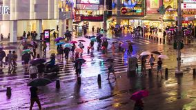 Day to night time lapse of traffic and people walking on crosswalk at Ximending with falling rain in Taipei, Taiwan. stock video footage