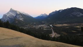 Day to night timelapse of Banff, Canada 4K. A Day to night timelapse of Banff, Canada 4K stock video footage