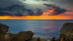 Day to night timelapse of stormy sunset from a beach on a Mediterranean island stock video footage