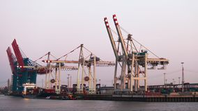 From day to night timelapse video of work on unloading containers in a cargo seaport ,Hamburg, Germany stock video