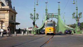 Day traffic at Liberty Bridge in Budapest. Day car and people traffic at Liberty, or Freedom, Bridge across Danube in summer stock video footage