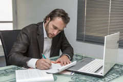 Day traider. Is a day trader in his office working day royalty free stock photography