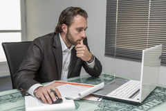 Day traider. Is a day trader in his office working day stock photography