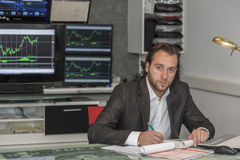 Day traider. Is a day trader in his office working day Royalty Free Stock Image