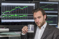 Day traider. Is a day trader in his office working day stock photos