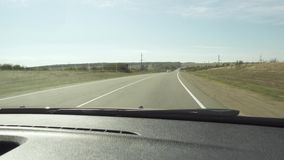 Day trip on asphalt road descent and turn. With the oncoming cars among the hills and trees stock video footage