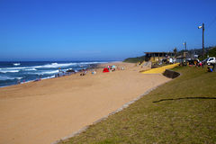 Day Trippers to Westbrook Beach at Tongaat. DURBAN, SOUTH AFRICA - APRIL 19, 2014: Numerous day trippers enjoy sunny weather on Westbrook beach at Tongaat in Stock Photos
