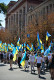 Day of ukrainian flag. In Dnepropetrovsk, 23 August, celebrate Flag Day. All residents are located on street with yellow-blue flag of Ukraine. On the streets of Stock Photo