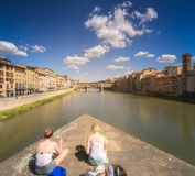 Ponte Vecchio and Arno River in Florence, Italy. Day vew of bridge Ponte Vecchio and the Arno River from Ponte Santa Trinita Holy Trinity Bridge in Florence Royalty Free Stock Photography