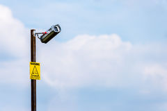 Day View of Broken CCTV camera with yellow notice Royalty Free Stock Photo