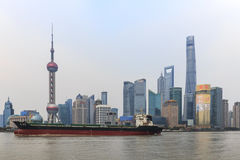 Day view of the Bund, the most scenic spot in Shanghai with the most famous Chinese skyscrapers Stock Image