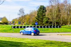Day view of busy traffic on UK Motorway roundabout Stock Photography