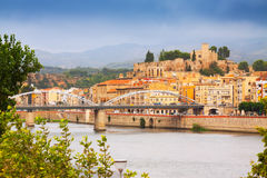 Day view of Ebro river with bridge and Suda Castle in Tortosa Royalty Free Stock Image