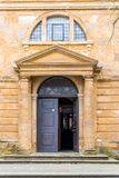 Day view of entrance door to Holy Cross Church in Daventry town centre.  stock photography