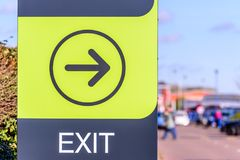 Day view of Exit Directional sign logo at Riverside Retail Park Northampton UK Stock Image