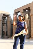 Egyptian woman at Temple of Luxor - Egypt. Day view of Luxor Temple Luxor, Egypt stock photo