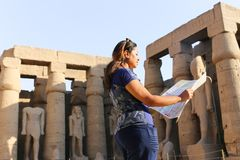 Egyptian woman at Temple of Luxor - Egypt. Day view of Luxor Temple Luxor, Egypt royalty free stock image