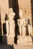 King and queen statue statue at Luxor temple. Day view of Luxor Temple Luxor, Egypt royalty free stock image
