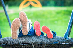 Day view mother and child feet on swings Royalty Free Stock Photography
