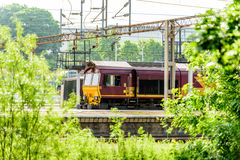 Day view old diesel locomotive at train station Stock Photos