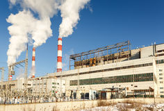 Day view of power plant, smoke from the chimney Stock Image