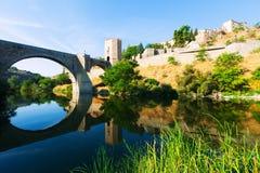 Day view of Puente de Alcantara - arch bridge Stock Photo