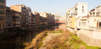 Day view of river and picturesque homes in Girona. Catalonia, Sp. Picturesque houses on river Onyar and Eiffel bridge in Gerona. Catalonia, Spain stock image