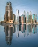 Day view of sea bay in Dubai Marina, UAE. Panoramic day view of sea bay in Dubai Marina with reflection on water, UAE royalty free stock photo