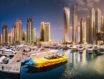 Day view of sea bay with yachts Dubai Marina, UAE. Panoramic day view of sea bay with yachts at sunset in Dubai Marina, UAE Stock Image