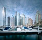Day view of sea bay with yachts Dubai Marina, UAE. Panoramic day view of sea bay with yachts at sunset in Dubai Marina, UAE Stock Photo