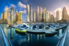 Day view of sea bay with yachts Dubai Marina, UAE. Panoramic day view of sea bay with yachts during sunset in Dubai Marina, UAE Stock Photo