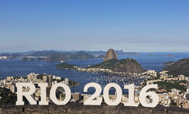 Day view of Sugar Loaf Mountain, Rio de Janeiro, Brazil. Day view of Sugar Loaf Mountain and Guanabara Bay with the words RIO 2016 in front of it, Rio de Stock Images