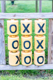Day view of Tic Tac Toe game outside playground Stock Photos