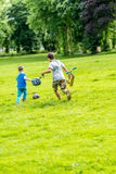 Day view of two boys playing football summer park Royalty Free Stock Photo