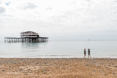 Day view of two women over Brighton Pier after fire Stock Photo