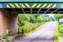 Day view of UK motorway highway under railway bridge Royalty Free Stock Photography