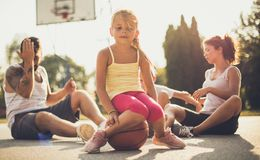 This day was full of games and sports. Family on basketball playground. Close up stock photos