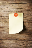 Day of week Sticky note with pin over wooden background Stock Image