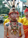 Dayak clothes. People wearing Dayak traditional clothes when he joined the  cultural carnival in the city of Solo, Central Java, Indonesia Stock Photos