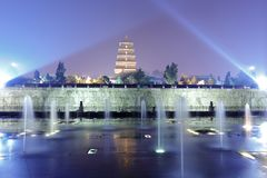 Searchlights illuminated  music fountain of dayanta pagoda, adobe rgb. Dayan tower scenic area of xi`an city, shaanxi province, china. big wild goose pagoda is Royalty Free Stock Photos