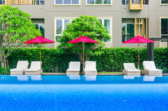 Daybed by the pool with residents. Royalty Free Stock Photo